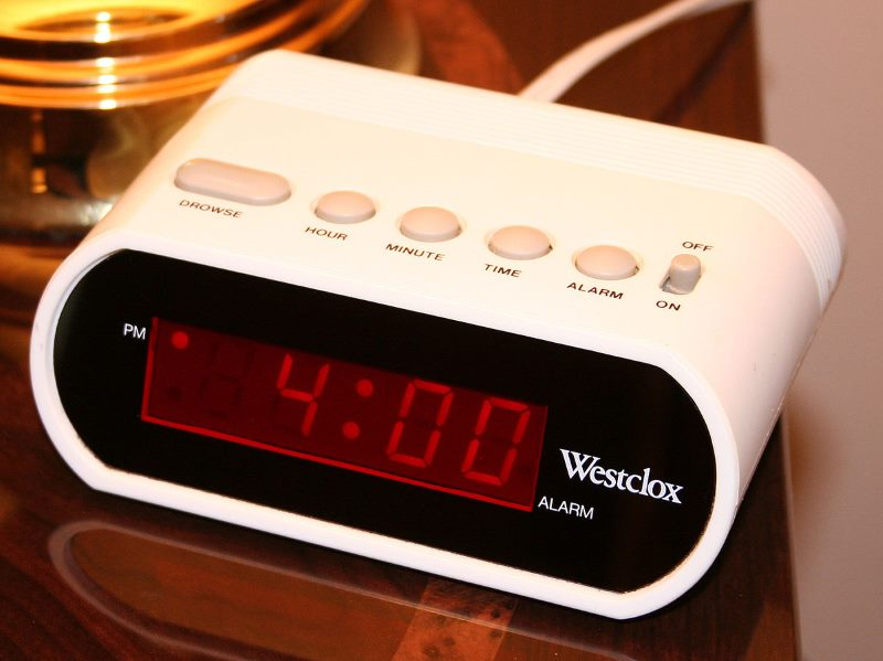 Image of a digital alarm clock radio showing time 4:00 PM