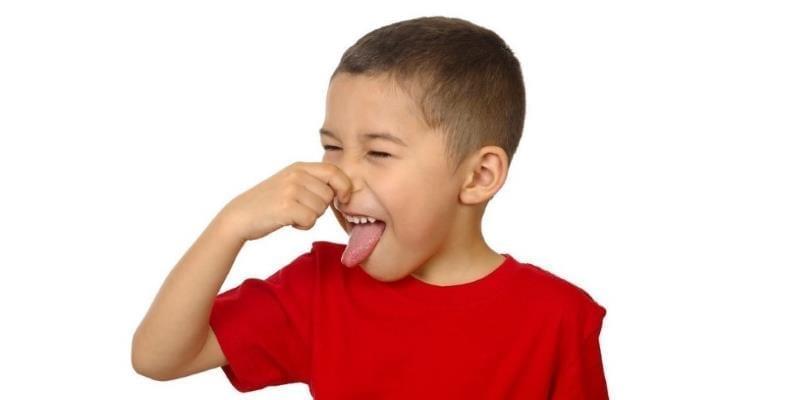 Boy pinching nose bad smells