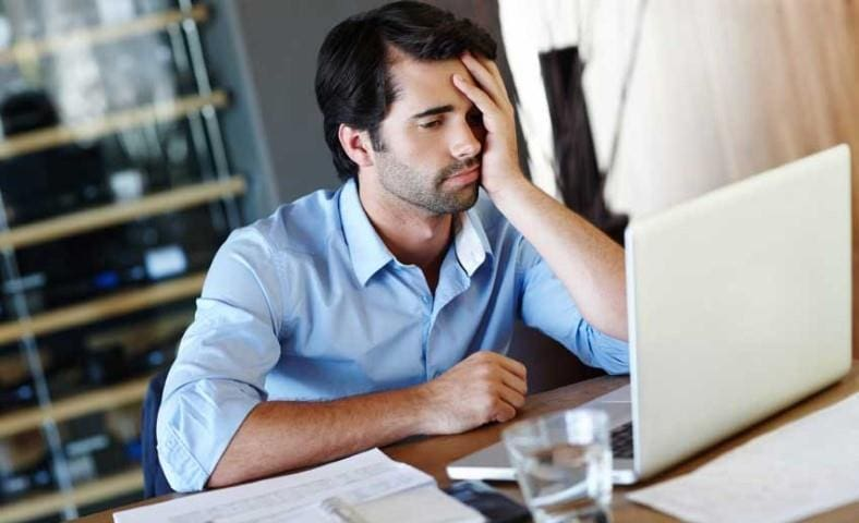 Frustrated man at computer image