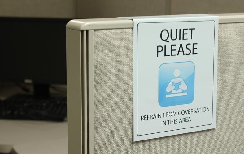 Cubicle with quite please sign