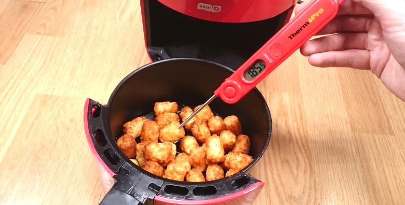 Image showing how to check tater tots internal temperature with a digital food thermometer