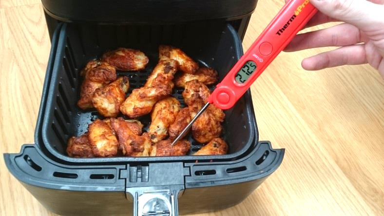 Image showing how to check the internal temperature of wings with a digital food thermometer - ThermoPro TP03A