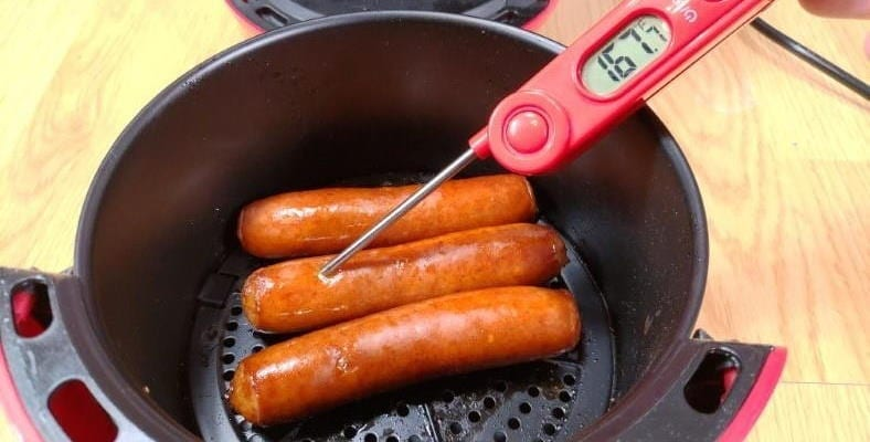 Image showing example of measuring the internal temperature of sausage hot dogs