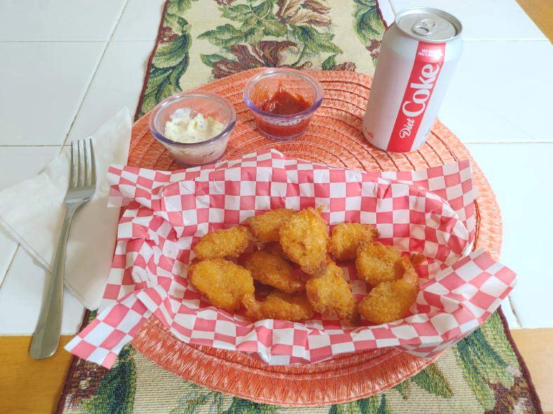 Image of cooked breaded shrimp served as a meal with sauce