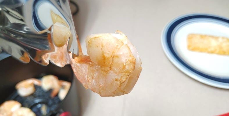 Closeup example of raw shrimp cooked with an air fryer