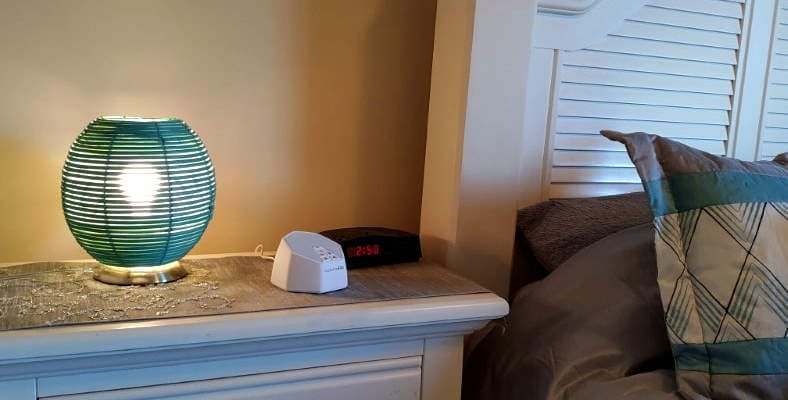 LectroFan Evo white noise machine in a bedroom