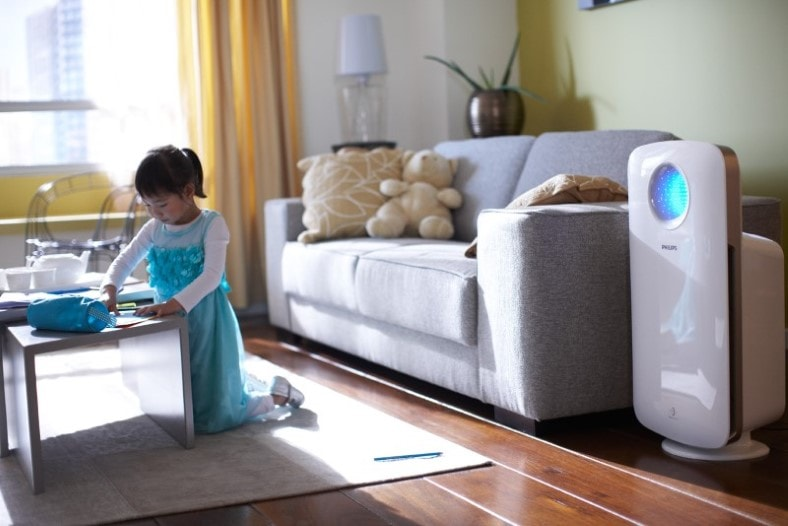 Image of child in living room with air purifier